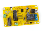 Assembled credit card sized yellow PCB with ART CONTROLLER silkscreen.
