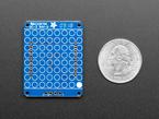 "Back of Adafruit 1.2"" 8x8 LED Matrix Backpack next to US Quarter for scale."