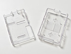Topdown shot of two clear acrylic assembly pieces for clear raspberry pi model A or B case.