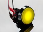 angled shot of illuminated large yellow arcade button with LED.