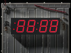 Huge red 7-segment clock display with all segments lit