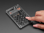 """Hand using calculator with some segments lit up """"7.8"""""""