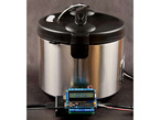 """Large cylindrical hot pot with Arduino in front with LCD screen displaying """"Sous Vide"""""""