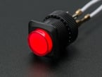 Angled shot of a red 16mm illuminated pushbutton.