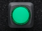 Top-down shot of green round pushbutton.