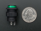Green round 16mm pushbutton next to US quarter.