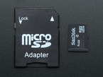 4GB Micro SD Card with NOOBS Lite 1.4 next to SD Adapter