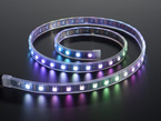 Coil of green, blue and purple lit digital LED strip