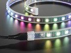 Close up of rainbow-lit LED strip connected to USB cable