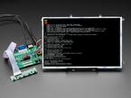 "Angled shot of assembled 10.1"" Display & Audio 1280x800 IPS - HDMI/VGA/NTSC/PAL. The HDMI screen displays a Terminal readout."