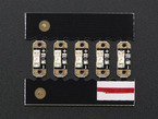 Front of PCB array with 5 sequins showing components and polarity