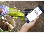 """Person holding phone with text """"YOU HAVE A DELIVERY"""" and inset image of someone pressing an SMS doorbell"""