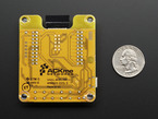Back of breakout board, with ACKme Networks logo. Next to quarter