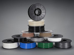 Filament for 3D printers in various colors and types stacked together.