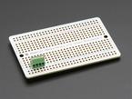 Single green 4-pin 2.54mm terminal block on a half-sized perma-protoboard.