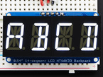 """Assembled Quad Alphanumeric Display with white display showing """"ABCD"""""""