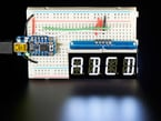 """Display wired to an Arduino on breadboard showing """"ABCD"""""""