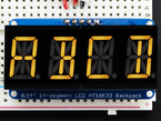 "Assembled Quad Alphanumeric Display with yellow display showing ""ABCD"""