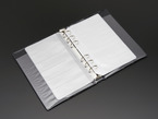Opened book showing ring binder and blank SMT loose-leaf pages