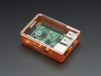 Angled shot of assembled orange Pi Model B+ / Pi 2 / Pi 3 Case Base with clear lid.