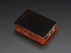 Angled shot of assembled orange Pi Model B+ / Pi 2 / Pi 3 Case Base with black lid.