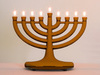 Electronic Menorah with warm white LEDs sitting on table