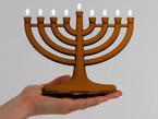 hand holding up menorah kit
