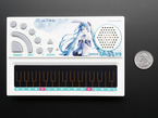 Top view of Pocket Miku Vocaloid Synth next to US quarter for scale.