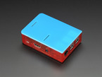 Assembled red acrylic Raspberry Pi case with blue lid.