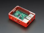 Assembled red acrylic Raspberry Pi case with clear lid.