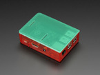 Assembled red acrylic Raspberry Pi case with green lid.