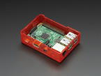 Assembled red acrylic Raspberry Pi case with no lid.