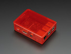 Assembled red acrylic Raspberry Pi case with red lid.