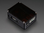Assembled smooth black Raspberry Pi enclosure with black lid.