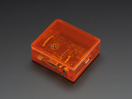 Angled shot of orange Raspberry Pi Model A+ Case with orange lid.