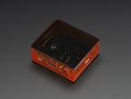 Angled shot of orange Raspberry Pi Model A+ Case with black lid.
