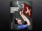 "Front cover of ""Hackaday Omnibus - Vol. 01 - 2014"". Side profile of a dark-haired white man with glasses with a book and soldering iron."