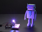 Very bright LED bathing robot figuring in purple light