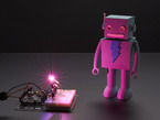 Very bright LED bathing robot figuring in pink light