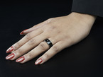 Female hand with ring on ring finger