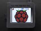 """Top-down shot of assembled 2.4"""" PiTFT HAT. The TFT display shows a raspberry logo."""