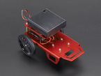 Assembled red metal robot with two wheels and caster, with AA battery pack attached on second level.