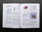 Open book spread featuring strain-gauge amplification and plastic film force sensors.