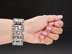 Wrist with chunky metal bracelet