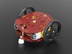 Assembled round red metal robot with two wheels and caster.