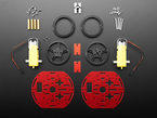 Kit component shot with round metal pieces, wheels, motors and other hardware.