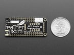 Back shot of Adafruit LoRa Radio FeatherWing - RFM95W 433 MHz measured by a US quarter