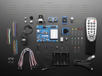 Parallax Blockly Prop Starter Kit showing PCB, many components and remote control