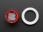Disassembled mini LED arcade button parts.