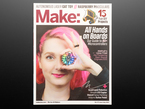 Front cover of Make: Magazine - Vol 57. All hands on boards. Our guide to 80+ microcontrollers. Adafruit's Limor Fried. the pioneering open-source engineer/CEO. Quadrupled robotics. Simple LED copter. Stencil spray painting. Arduino guitar pedal. Portrait of a white woman with short curled pink hair. She holds up a round dev board with rainbow-lit LEDs up to cover her left eye.
